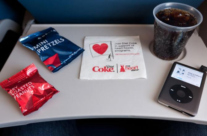 Tray table with Delta Air Lines snacks
