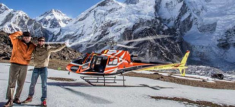 Helicopter in front of snowy mountain range